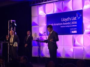 Arnold Witte, Chairman of the Board of Directors of The American Club, receives the Award.