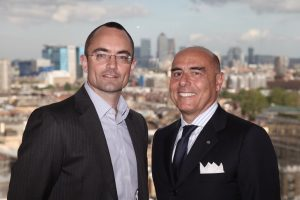 Ugo Salerno CEO RINA S.p.a. (right) and Tim Dunn Partner Phoenix Equity Partners (left) sign the contract for RINA's acquisition of the Edif Group