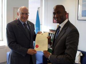 Tafawa Williams, Alternate Permanent Representative of Saint Lucia to IMO, meeting IMO's Frederick Kenney