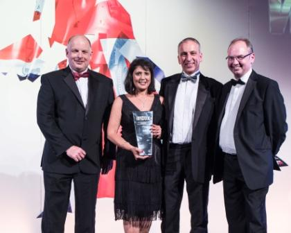 Savouring national recognition: l to r Peter Atmore, Marion and Adrian Maxwell with Peter Roberts of Weightmans who presented the award. Image courtesy of Brian Lake Photography.