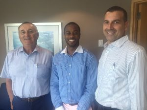 BDA Business Development Manager Kevin Richards, centre, with (from left) Len Cormier and Thomas Dunstan of the Department of Civil Aviation (DCA)