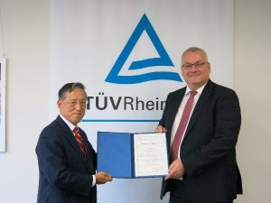 ClassNK Chairman and President Koichi Fujiwara handing over the appointment certificate to TÜV Rheinland's Executive Vice President Products Mr. Holger Kunz.