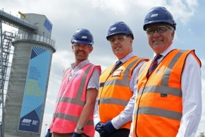l-r: Martin Green, CEO & Director, Hull 2017; Mark Frith, ABP Port Manager Hull & Goole and Simon Bird, ABP Regional Director Humber at the site of the supersize banner at the Port of Hull. Image courtesy of ABP/David Lee Photography