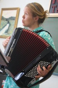 ... and on accordion, at her studio recital.