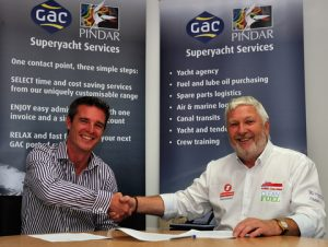 Murray Bishop, GAC Pindar Superyacht Services (left) and Alan Priddy, Team Britannia's Team Principal (right), sign the deal in Southampton
