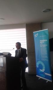 Minister Dimitriades at the podium