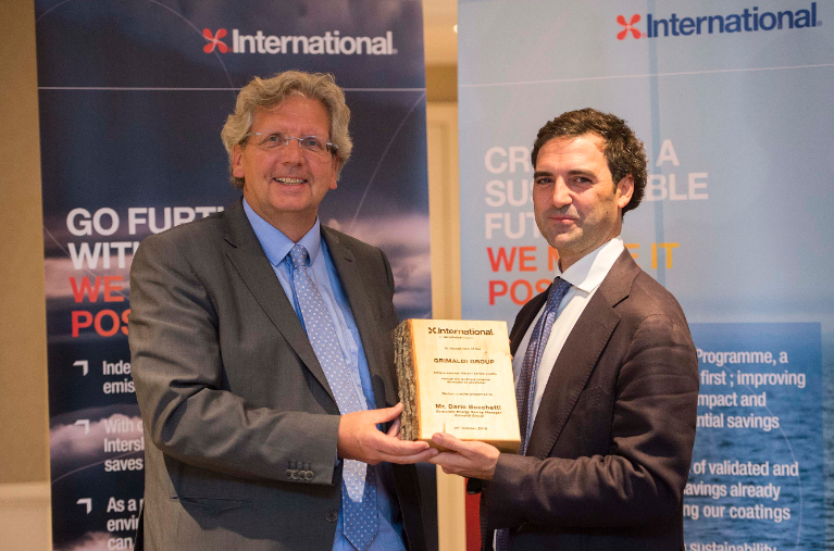 Dr André Veneman, Director of Sustainability, AkzoNobel, presents 109,617 carbon credits to Dario Bocchetti, Corporate Energy Saving Manager, Grimaldi Group.