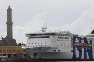 "Genoa lighthouse and GNV's ""La Suprema""."