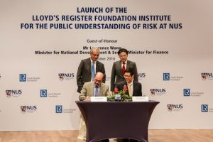 l to r seated: Prof. Richard Clegg, Managing Director of Lloyd's Register Foundation, Professor Tan Chorh Chuan, President of NUS.  Witnessing the signing ceremony was the Singapore Minister for National Development and Second Minister forFinance Mr Lawrence Wong (back row, right), and Mr. Lambros Varnavides, Lloyd's Register Foundation Trustee (back row left.