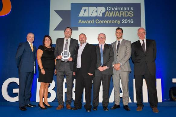 The team from Hull's All-Weather Terminal collect their award from ABP Chief Executive James Cooper, Welsh rugby captain Sam Warburton and ABP Chairman Robert Walvis (third, second and first right respectively)(image courtesy of ABP/David Lee Photography)