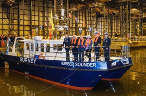 l-r ABP Senior Hydrographer, Mike Abbey; ABP Director Humber, Simon Bird; Fr Colum Kelly;  Mrs Lucia Bird, Harbour Master Humber, Andrew Firman and Coxswain, Peter Gillyon aboard the Humber Sounder in Hull's All-Weather Terminal (image courtesy of ABP)
