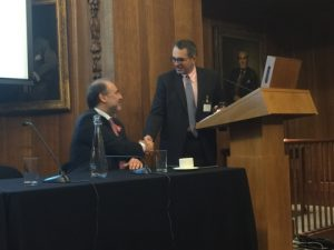 Paul B. Kazarian being congratulated by BHCC's Harris Ikonomopoulos following his impressive slides presentation