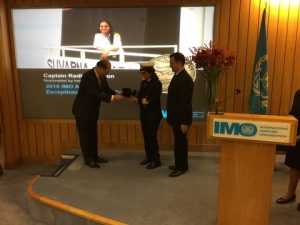 Captain Radhika Menon, Master of the oil products tanker Sampurna Swarajya receiving the award from the Secretary-General of the IMO in the presence of India's acting High Commissioner Dinesh Patnalk