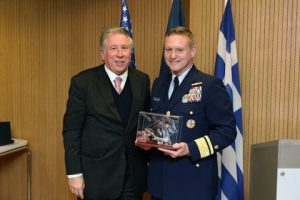 """Dr G. Gratsos presenting Admiral Thomas with a commemorative silver """"trireme"""""""