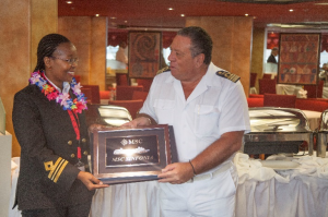 Port of Durban Deputy Harbour Master: Nautical, Captain Pinky Zungu, presents a gift to the Master of MSC SINFONIA.