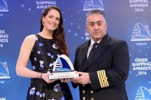 "Ms. Natalia Tsavliris-Vasilopoulos of sponsor Tsavliris Salvage Group presenting the Seafarer of the Year Award to Capt. Diamantis Papageorgiou of ""Nissos Rodos""."