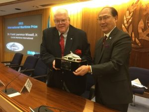 Dr. Frank Lawrence Wiswal Jr receiving the International Maritime prize from IMO's Secretary-General Kitack Lim