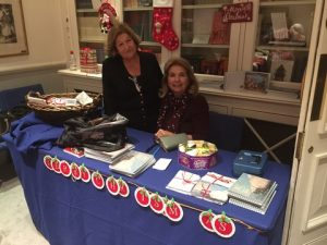 Sophy Niotis (standing) with Lydia Pateras at the Lyceum's stand selling gifts and promoting calendars including this year's special one, the Seascapes!