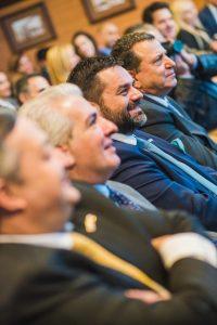 Audience view with the BoD members of the American Club, including Panayiotis J. Christodoulatos (Ikaros Shipping and Brokerage Co., Ltd.), George Vakirtzis (Polembros Shipping, Ltd.), Angelos D. Kostakos (Oceanstar Management, Inc.), Elias Gotsis (Eurotankers Inc.)