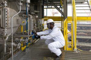 A DNV GL HazMat Expert doing a visual check for pipe gasket sampling.