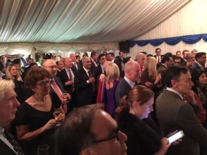 Guests gather for the brief speeches.